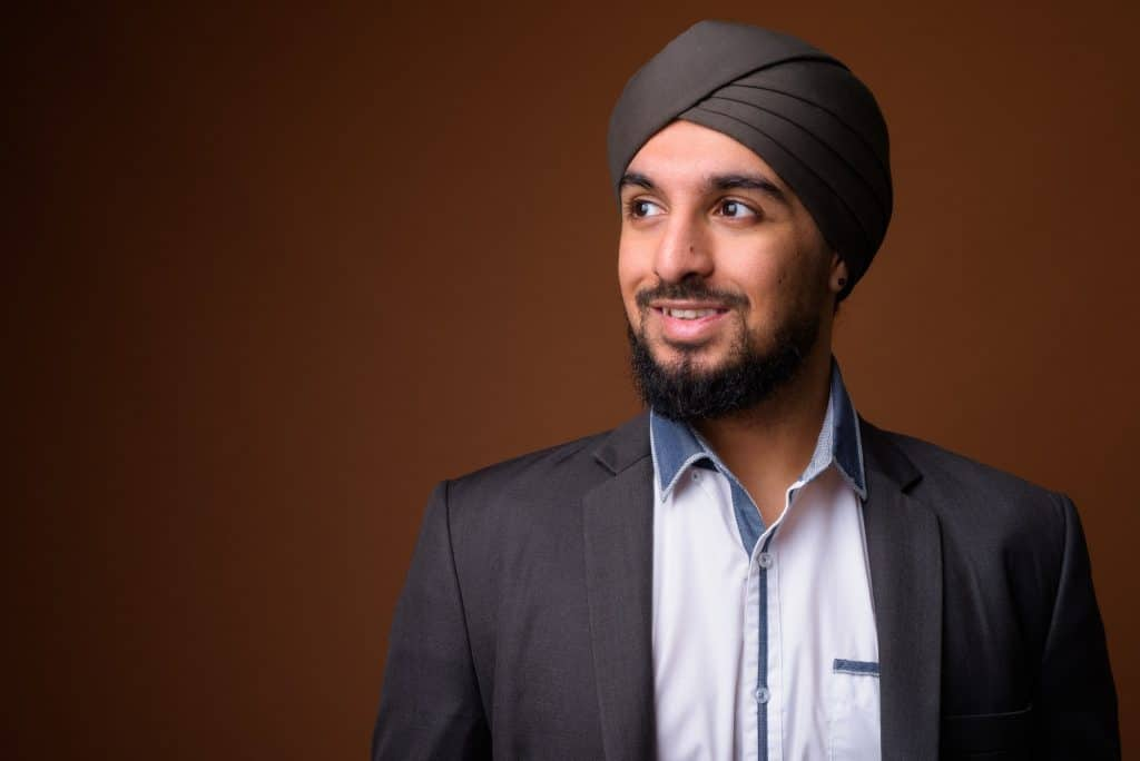 Young bearded Indian Sikh businessman wearing turban